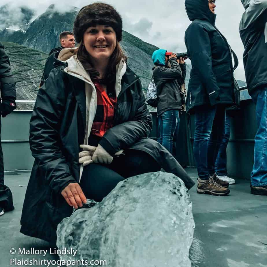 Mallory Lindsly in a Plaid Shirt and Yoga Pants hanging out in Endicott Arm and touching a large chunk of a glacier in Alaska!